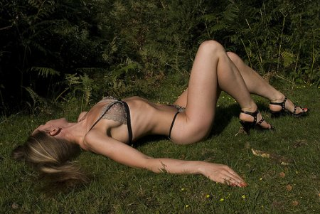 Female In Bikini Lying On The Grass