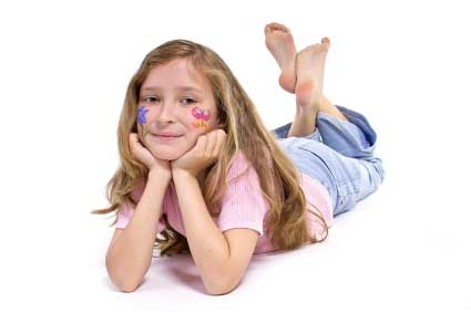 Young Girl Laying On Her Tummy On The Floor