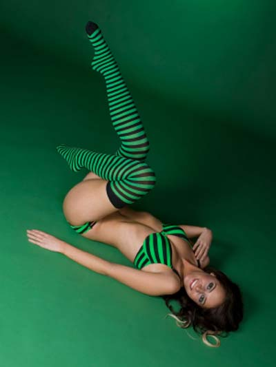 Model Laying On The Floor Posing With Her Legs In The Air And Her Toes Pointed