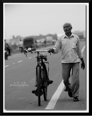 Man Walking With His Bicycle
