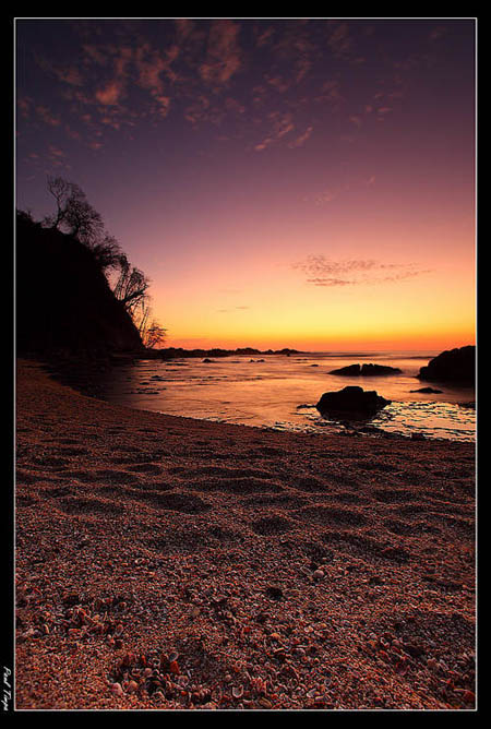 Using Manual mode to take a picture of a Sunset over a beach - By Paul Timpa
