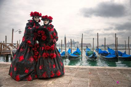 Two venetian masks in Saint Mark's, Venice, Italy.