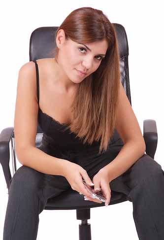Women Sitting On Chair Leaning On Her Knees