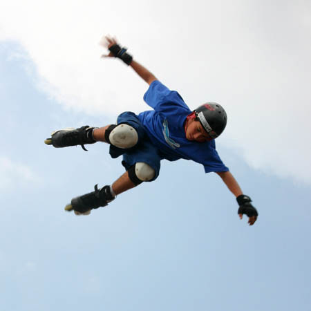 A Skater flying through the air performing a stunt