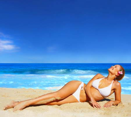 Beautiful Glamour Model Posing On The Beach