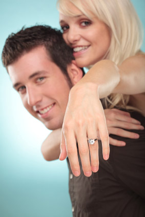Woman Jumping On Man's Back Showing Off Her New Engagement Ring
