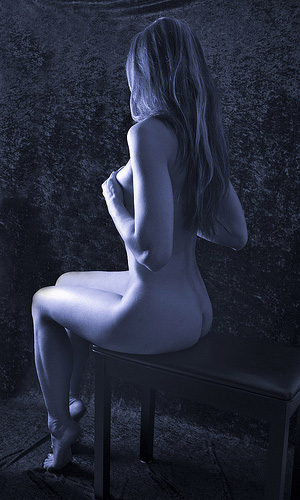 Female Nude Photography - Girl Sitting On Chair In Low Light