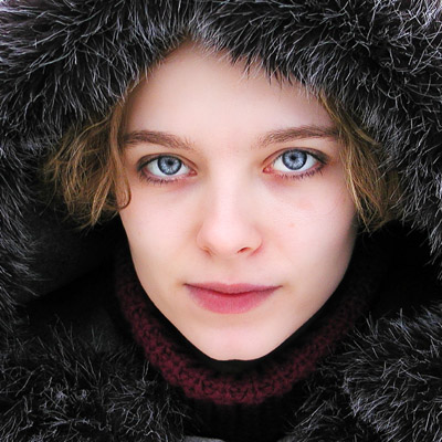 Woman Posing With Furry Hat And Icy Blue Eyes