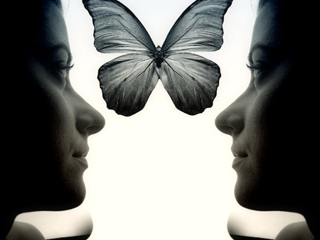 A Profile Pose Of Both Sides Of A Woman's Face With A Butterfly In Between