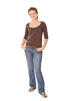 Women Posing Casually With Her Hands In Her Pockets